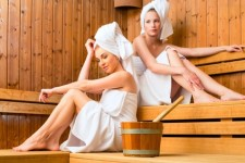 Two women enjoying Finish sauna